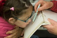 Photo Caption: A visually impaired child has her vision tested at the JBI Low Vision Clinic in Tel Aviv.