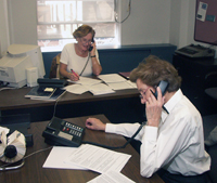 Photo Caption: Two volunteers help respond to the onslaught of telephone requests for JBI Large Print Haggadot prior to Passover