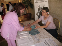 Photo Caption: A member of JBI's outreach staff at work informing her community about our free services