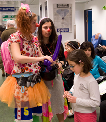 Photo Caption: Volunteer clowns entertain children in the waiting room of the JBI Low Vision Clinic Children's Clinic in Tel Aviv.